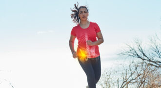 Shot of an attractive young woman running outdoors with her hip injury highlighted